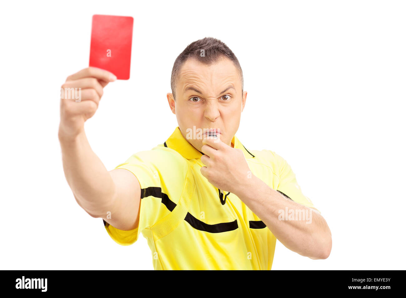 Furious football referee showing a red card and blowing a whistle isolated on white background - Stock Image