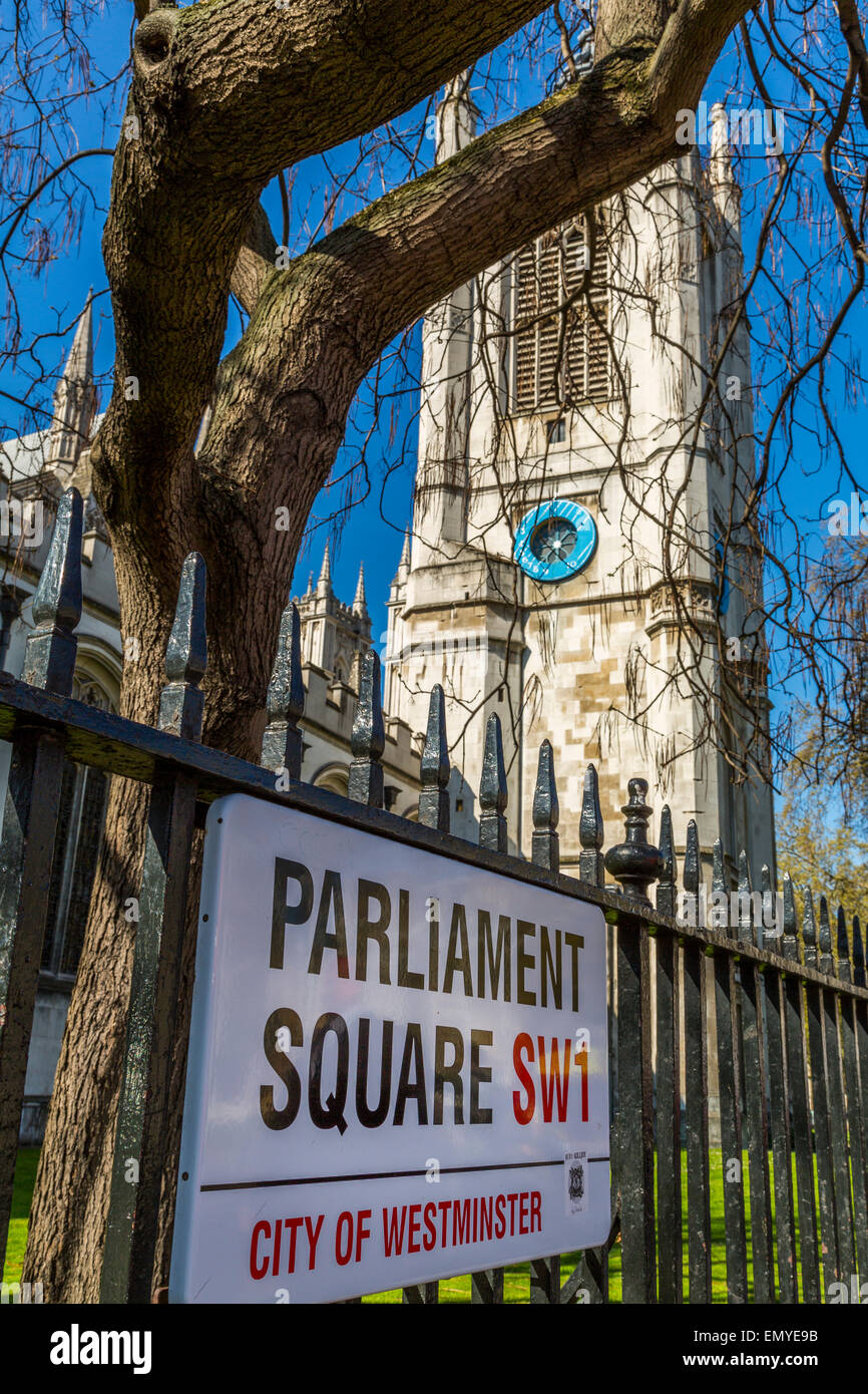 A view of the Parliament Square SWI road sign with Westminster Abbey in the background - Stock Image