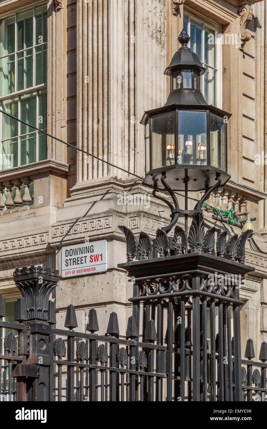 A portrait image of the gated entrance to Downing Street, office to the Prime Minister of England,  London England - Stock Image