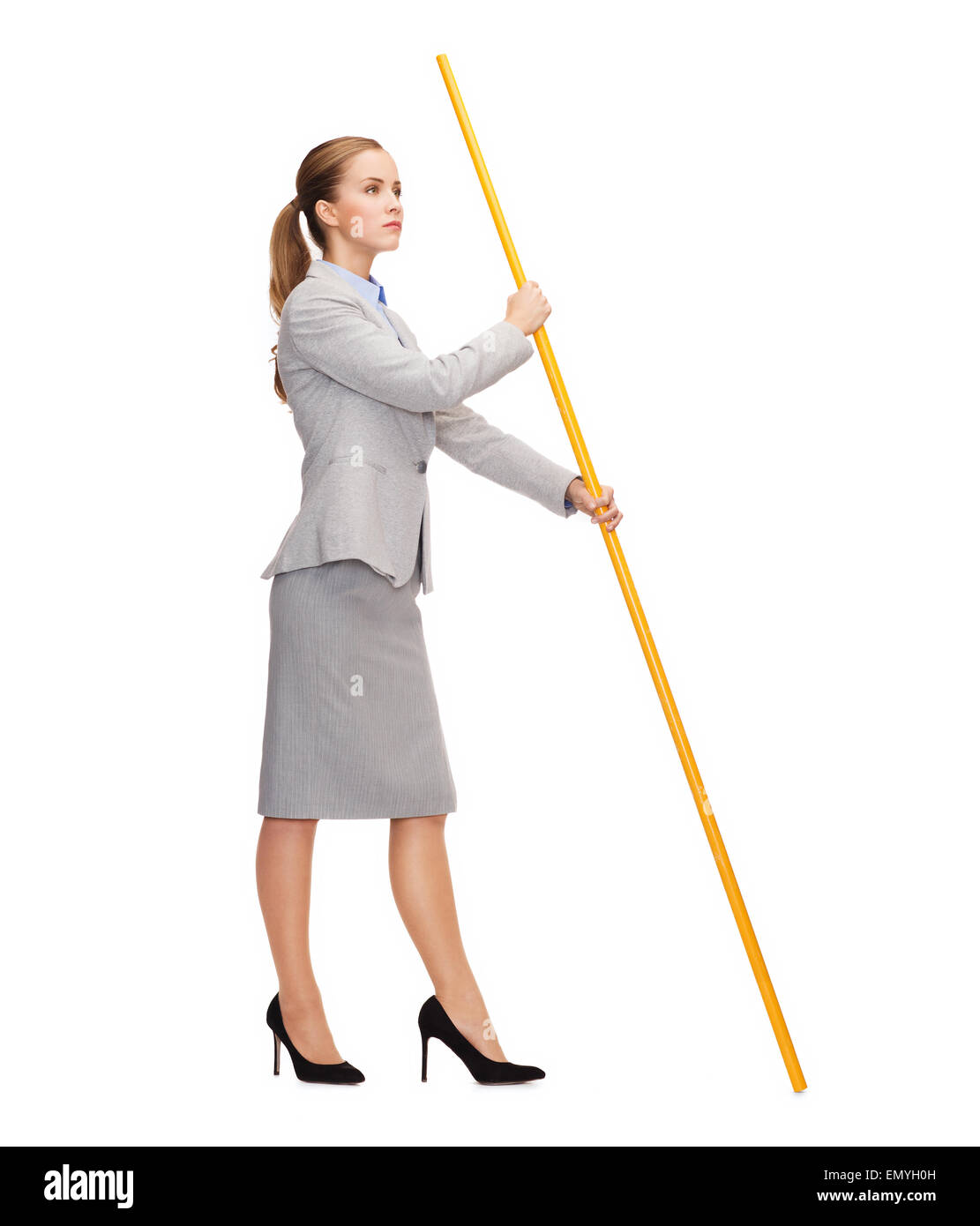 calm woman holding flagpole with imaginary flag - Stock Image