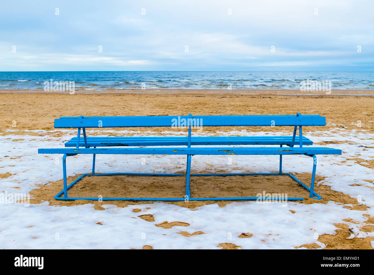 Winter view of a beach. Park bench on a winter beach. - Stock Image