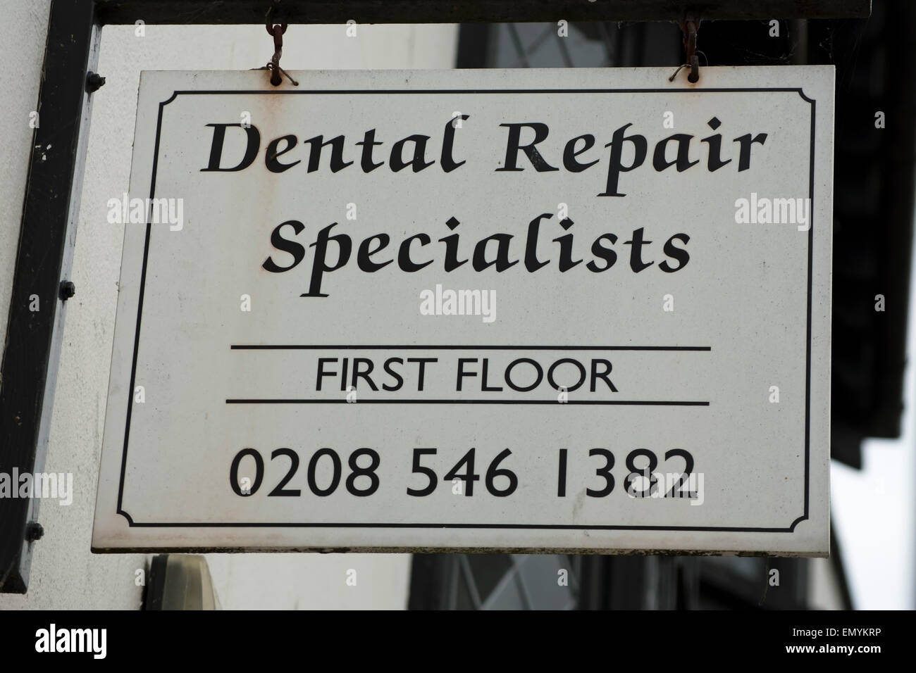 dental repair specialist hanging sign in kingston upon thames, surrey, england Stock Photo