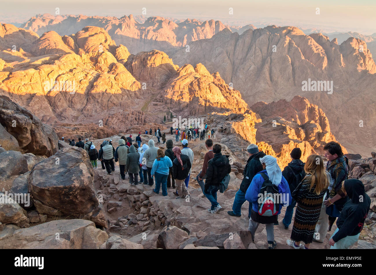 Pilgrims and tourists on the pathway from the Mount Sinai peak and panorama rocks of Mount Sinai - Stock Image