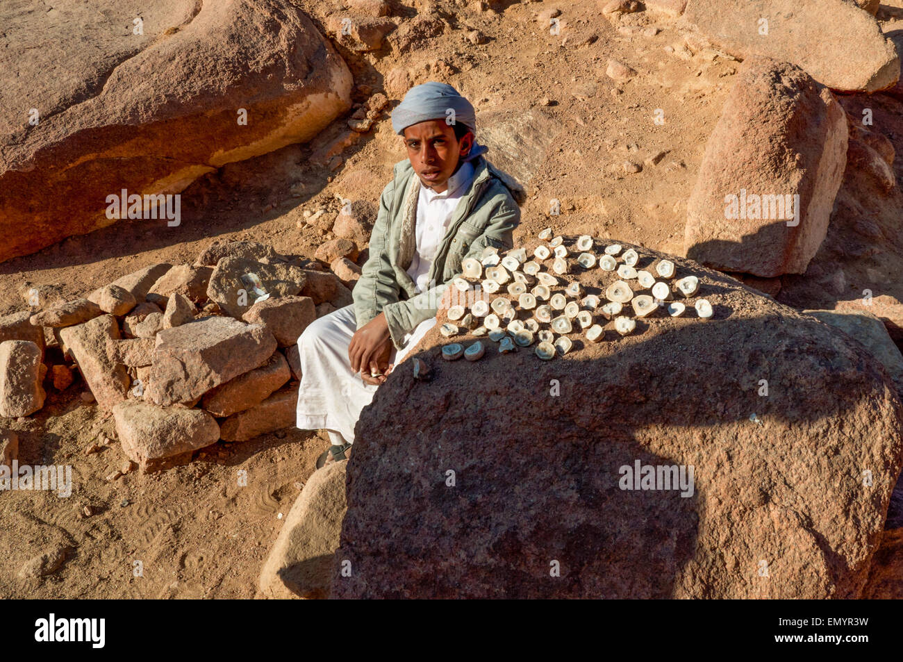 Bedouin guy near the Mount Sinai, who sells local stones as souvenirs to hiking pilgrims - Stock Image