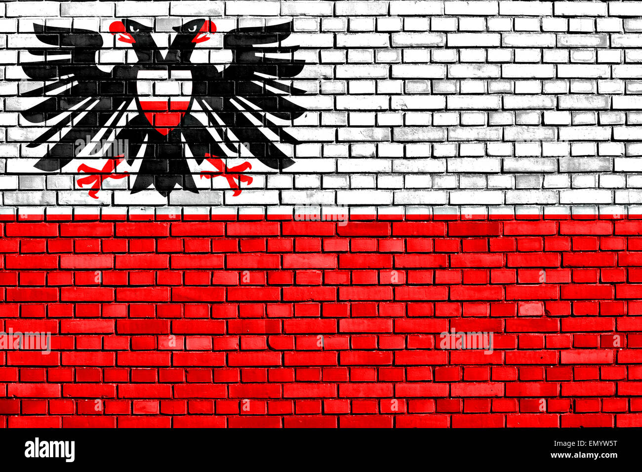 flag of Lubeck painted on brick wall - Stock Image