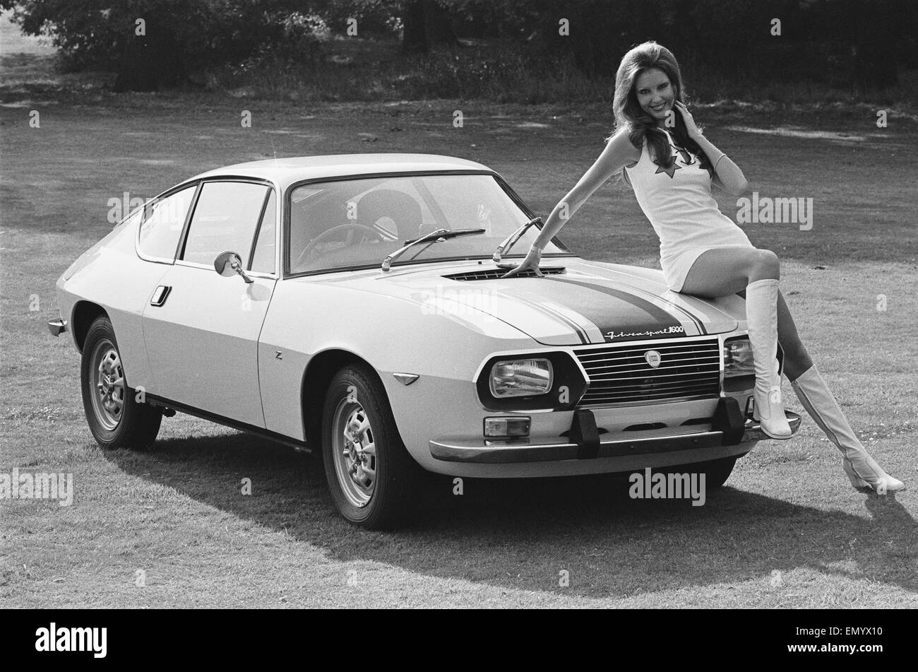 Reveille model Beulah Hughes seen here posing with a Lancia car which is a top prize in the Reveille win a car competition - Stock Image