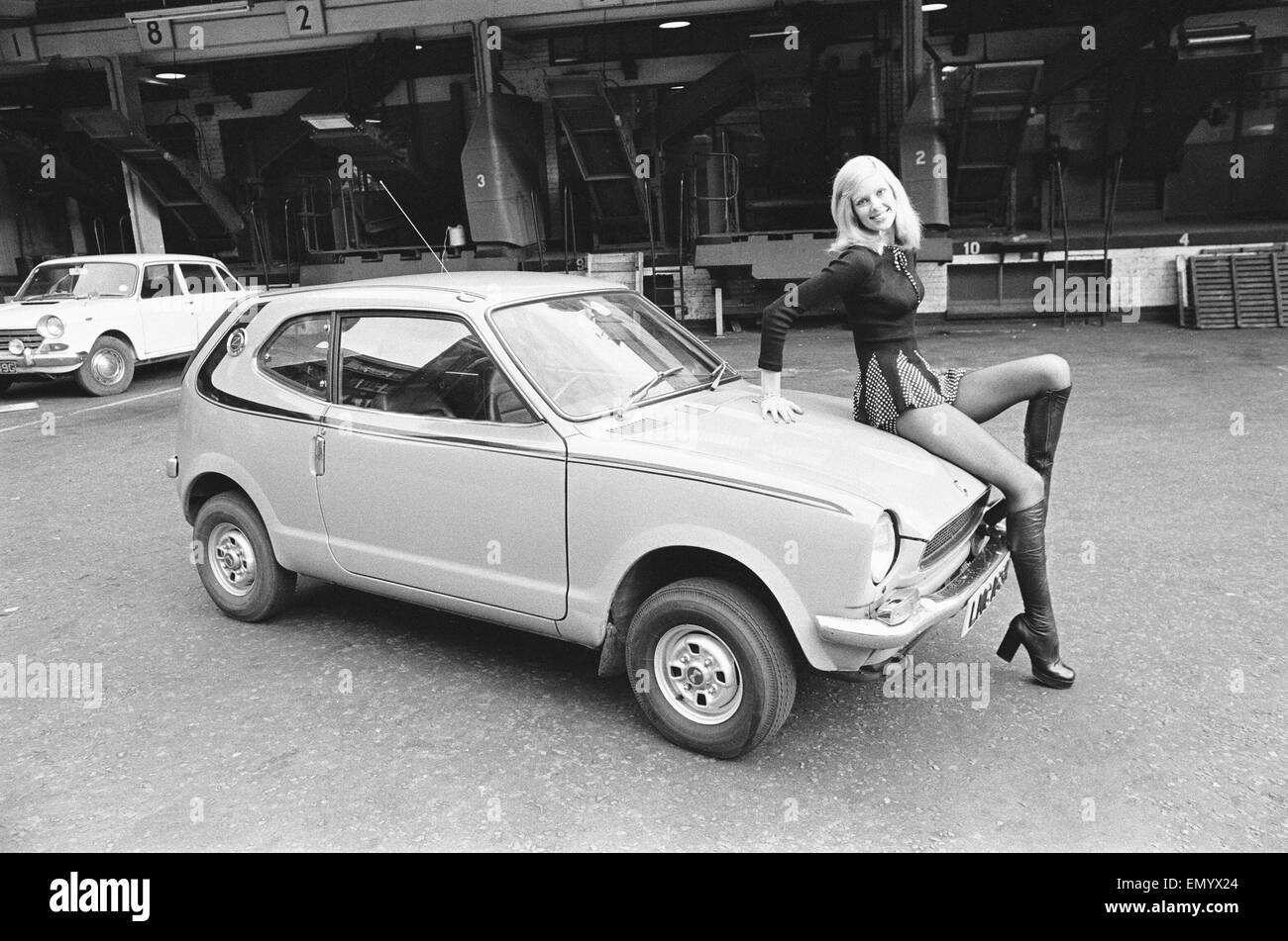 Reveille model Krista seen here posing with a Honda Civic