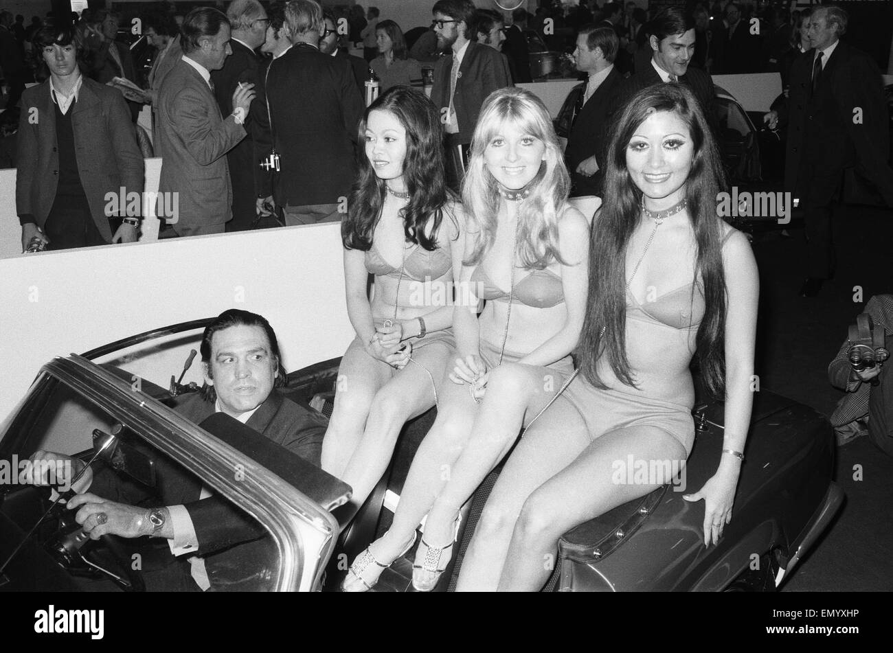 Models are driven to their stand at the 1971 Earls Court motor show 19th October 1971 - Stock Image