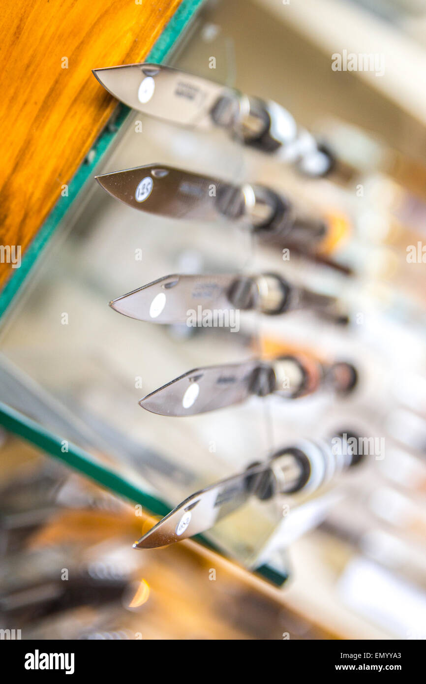 Knives on display in a shop window in the French town of Thiers. - Stock Image
