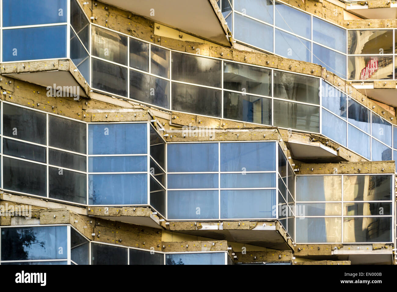 Sharp triangle window edges create acute angles in modern building design - Stock Image