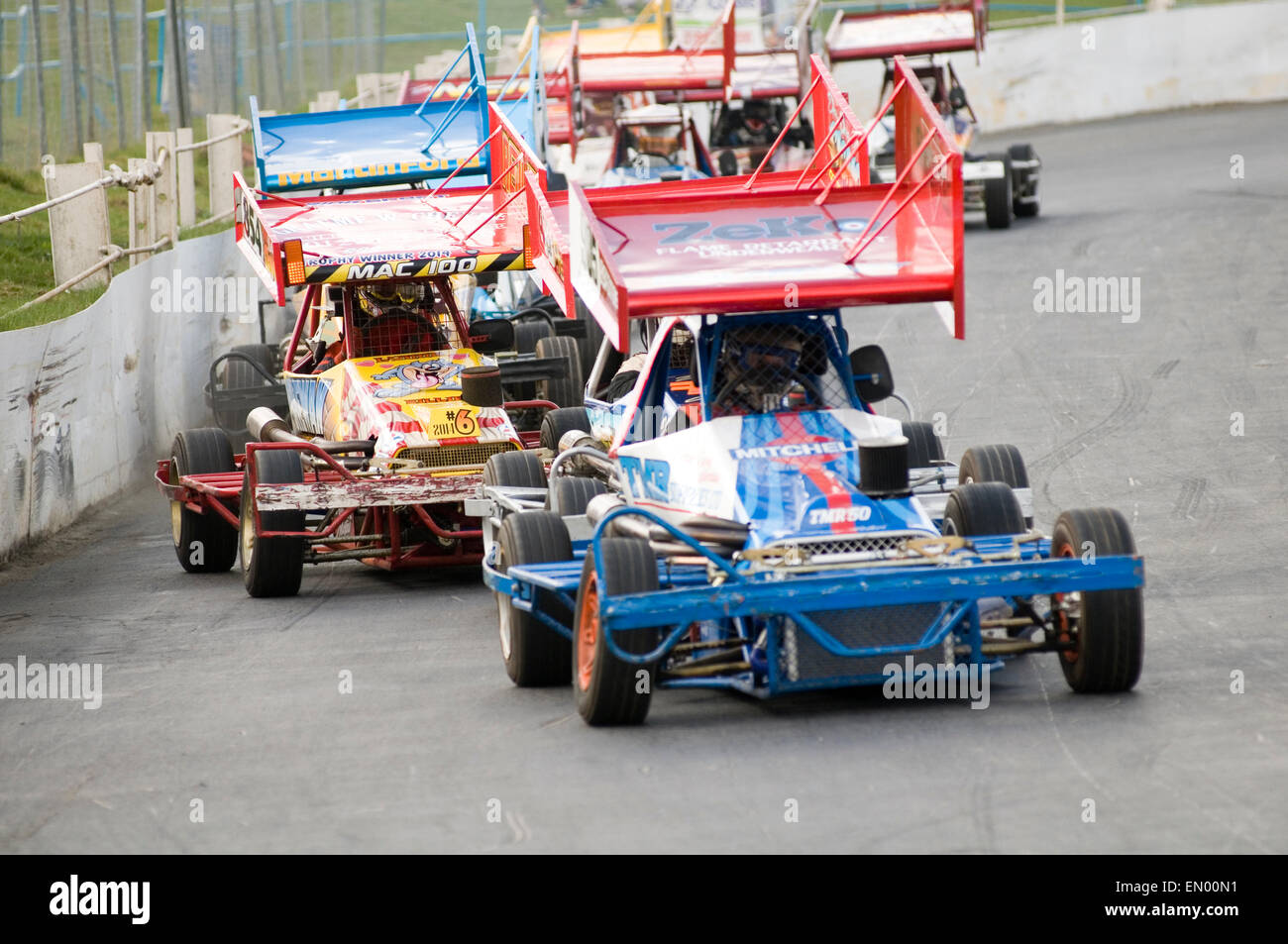f2 formula two 2 stock car cars race races racing oval track wing wings downforce open wheeled tarmac short motor - Stock Image