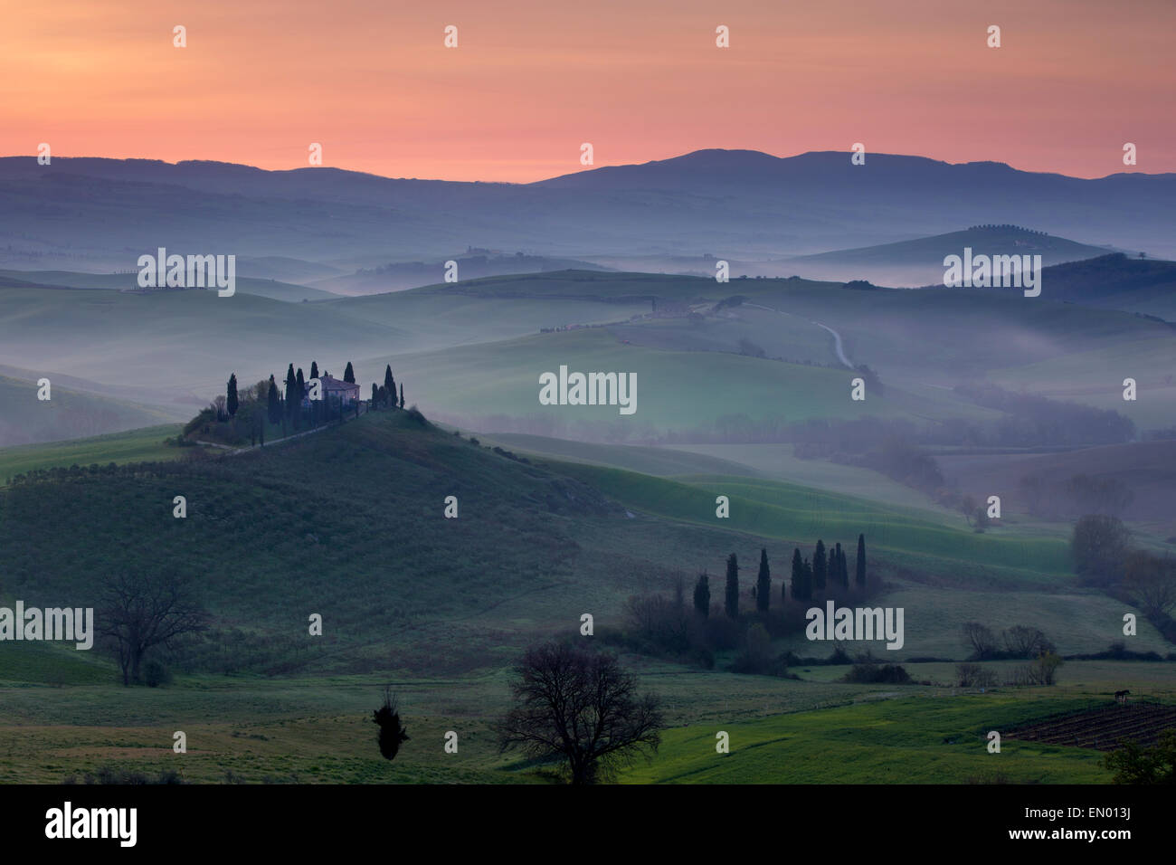 Podere Belvedere and Tuscan countryside at dawn, San Quirico d'Orcia, Tuscany, Italy - Stock Image