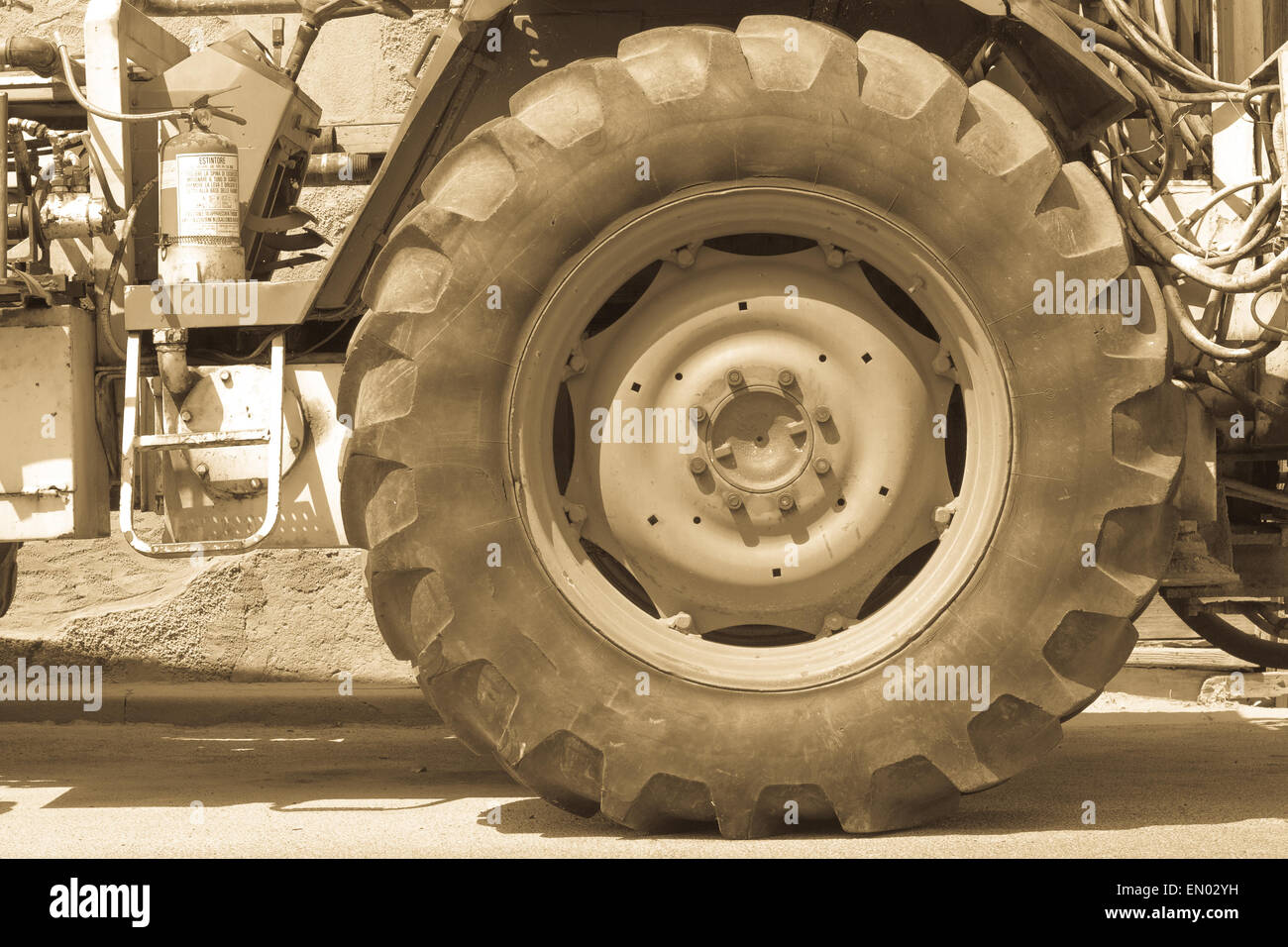 Driving wheel in old tractor. antiqued version . - Stock Image