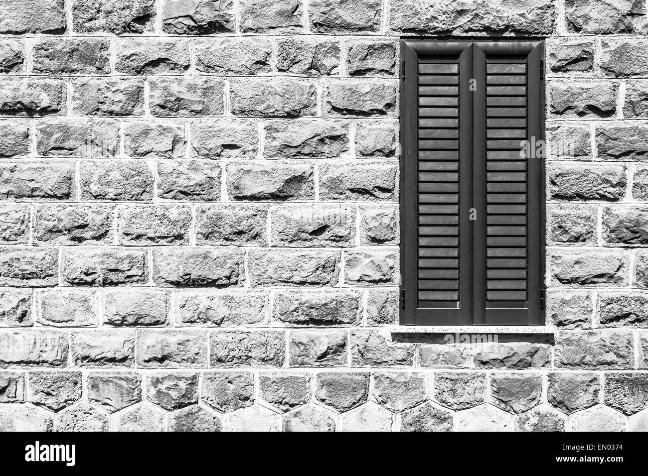 Window on the wall of basalt . - Stock Image