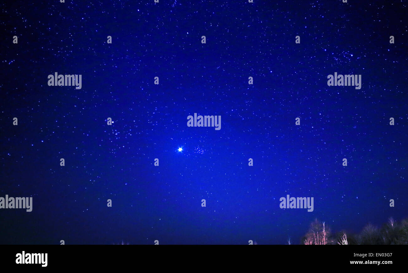 Planet Venus and Pleiades an open star cluster aka Messier 45, M45, Seven Sisters, forming close conjunction in - Stock Image