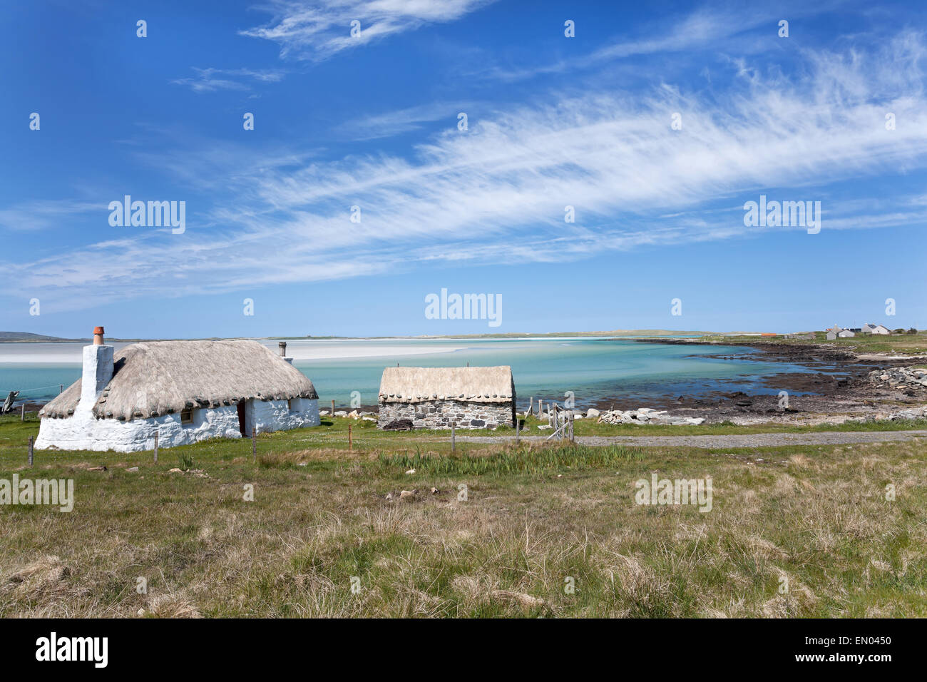 Croft house overlooking the sea, Western Isles of Scotland - Stock Image