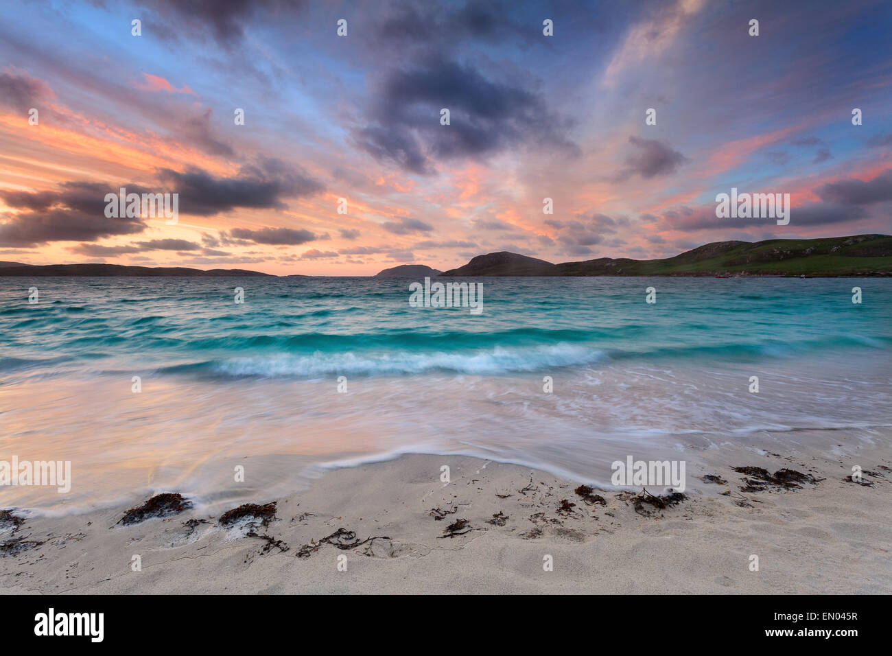 Stunning sunrise over Vatersay beach, Outer Hebrides - Stock Image