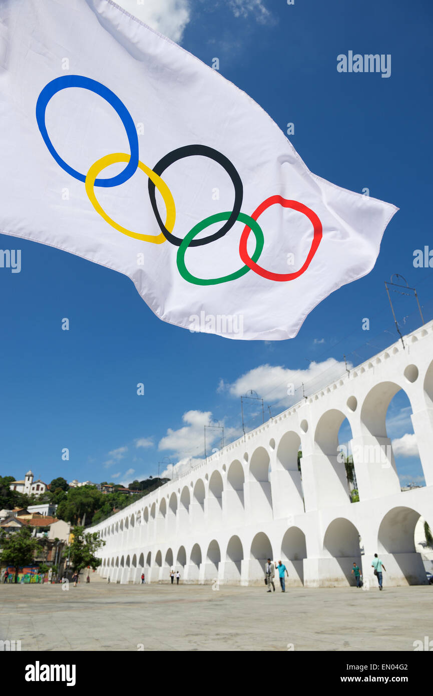 RIO DE JANEIRO, BRAZIL - MARCH 6, 2015: Olympic flag flies in the plaza above the famous Lapa Arches landmark. - Stock Image