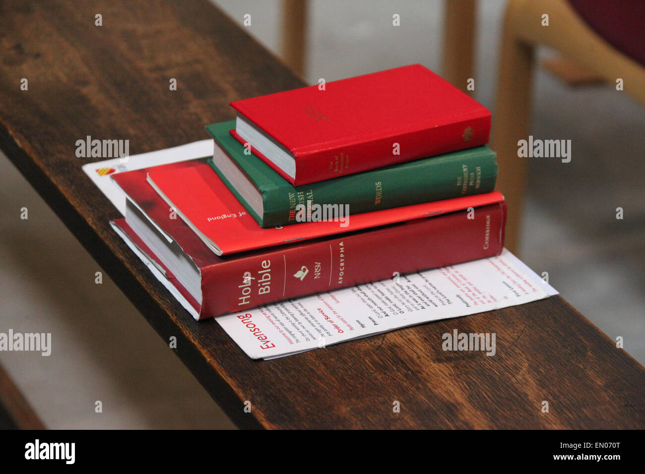 Pile of books in Manchester Cathedral - Stock Image