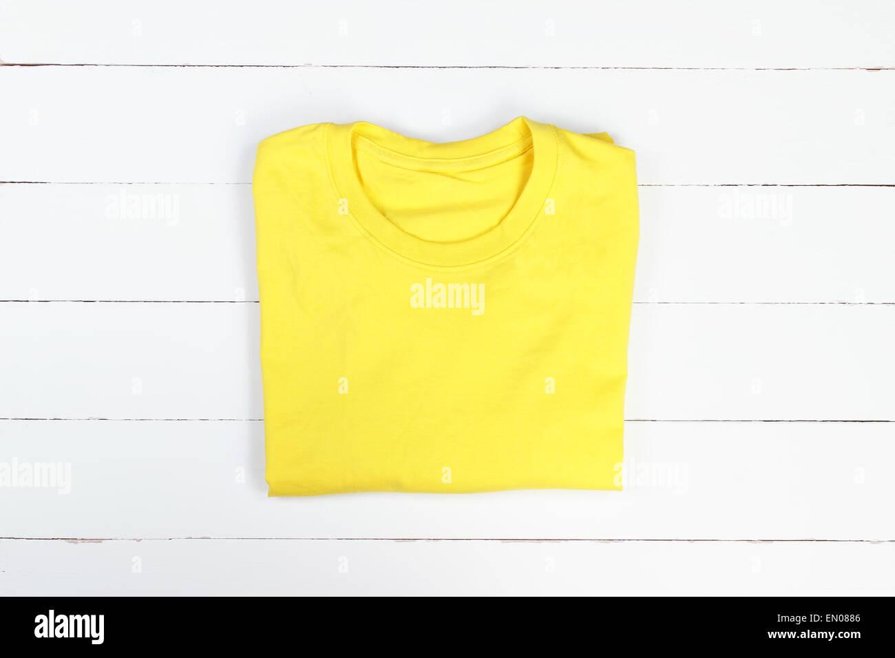 Yellow t-shirt - Stock Image