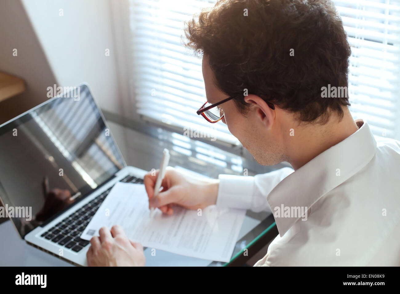 businessman working with documents in the office - Stock Image