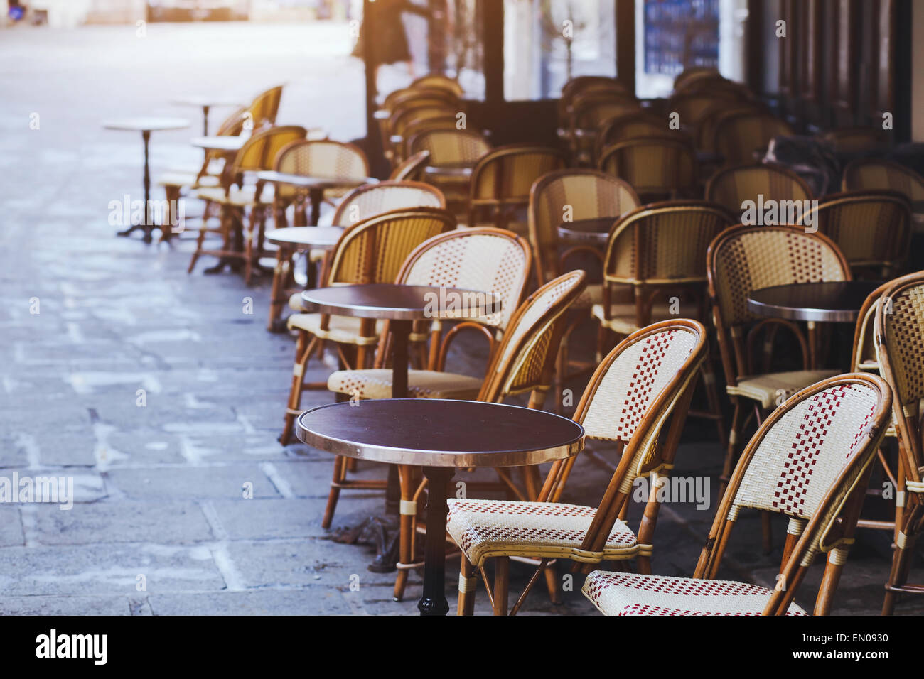 Traditional Cafe In Paris With Open Terrace Round Tables And Wicker - Paris cafe table