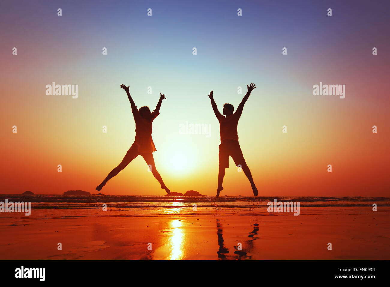 honeymoon of happy young family on the beach Stock Photo