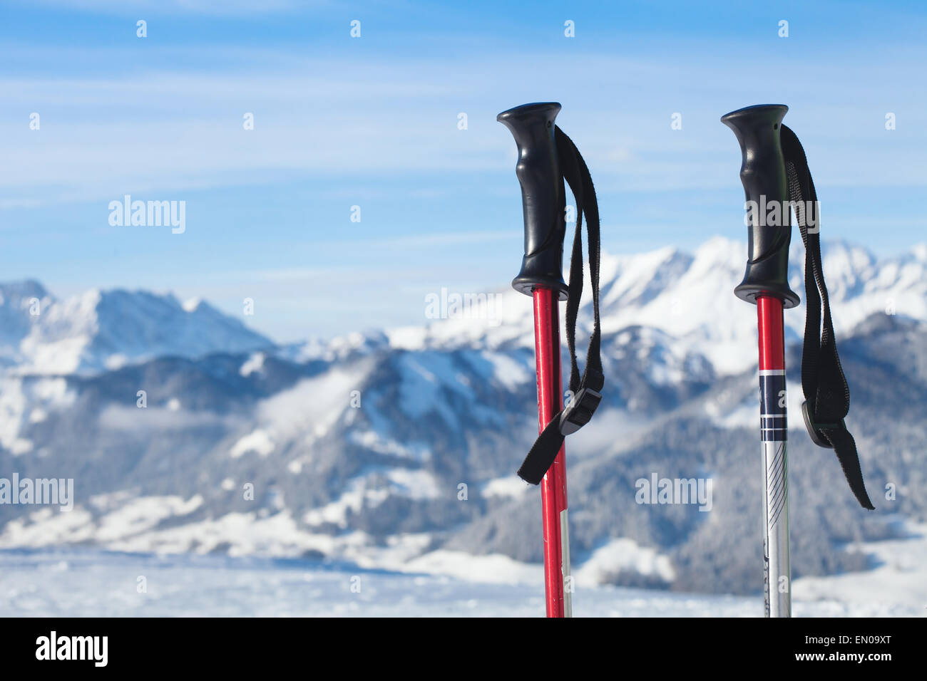 skiing in mountains, close up of two ski poles - Stock Image