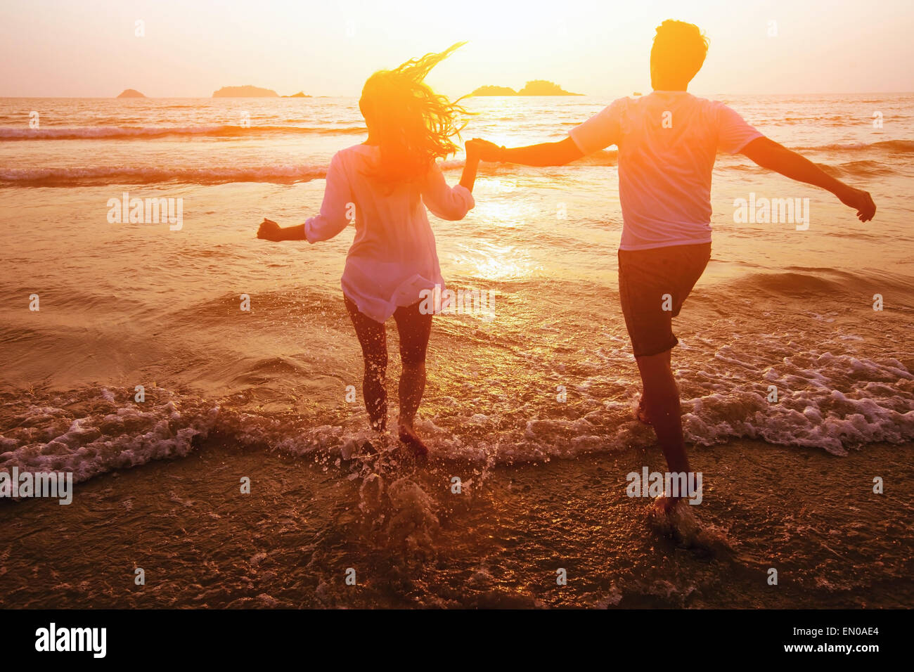 silhouette of couple on the beach, dream vacations - Stock Image