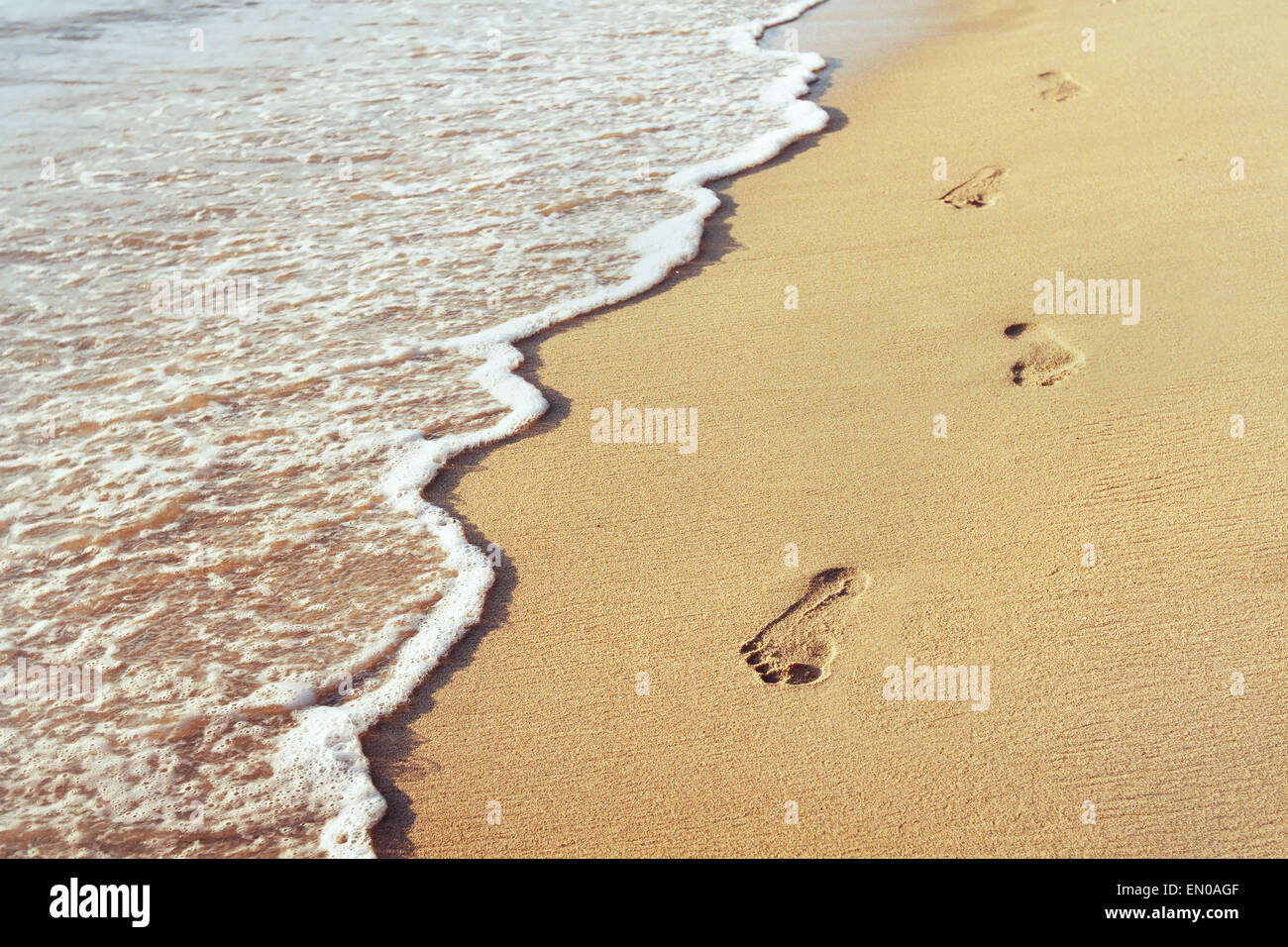 way to new life, wellbeing concept, Footprints in the sand - Stock Image