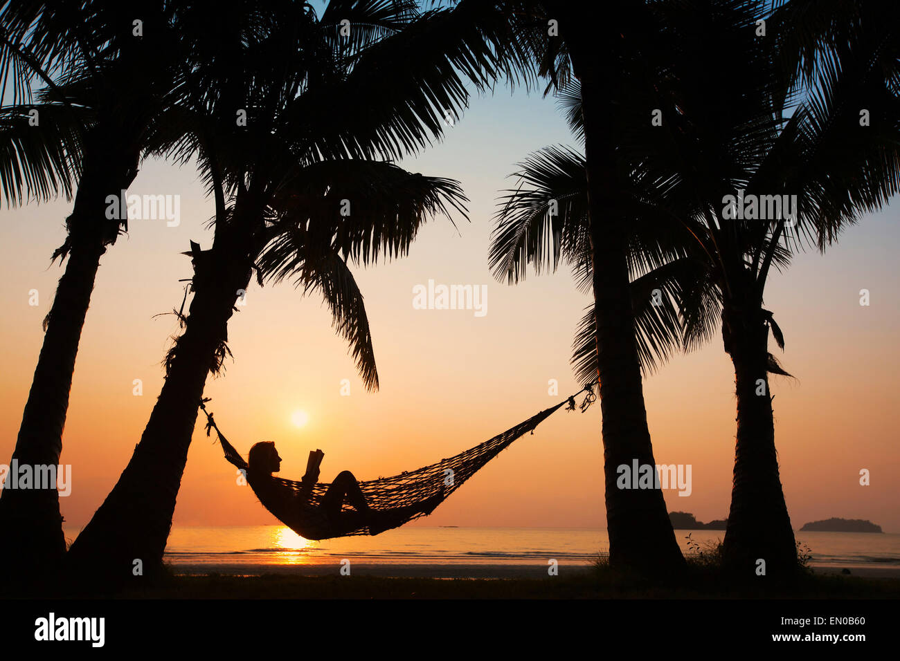 Beach Vacations Silhouette Of Woman Reading In Hammock