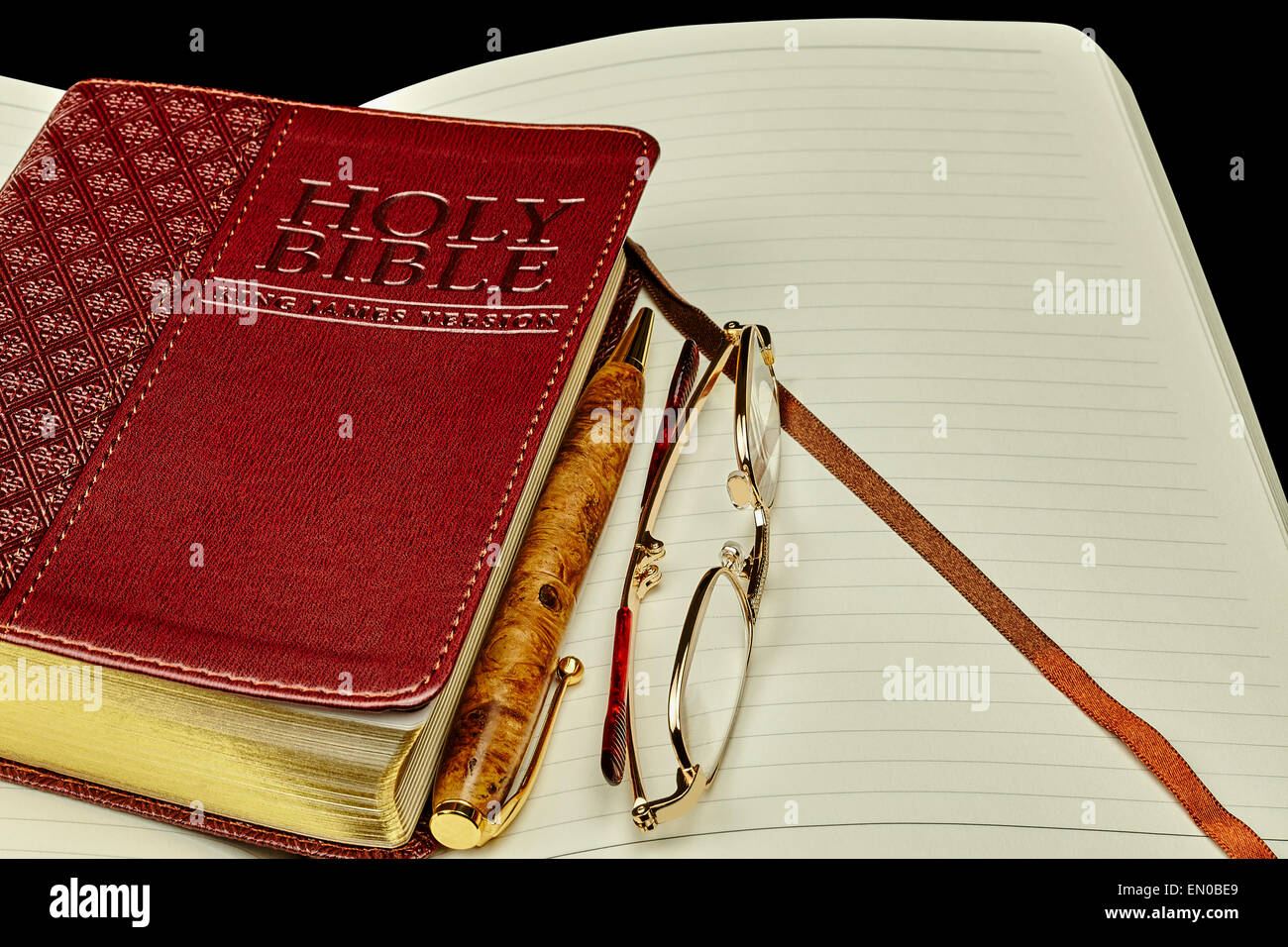 closed generic bible book with personal study journal and business