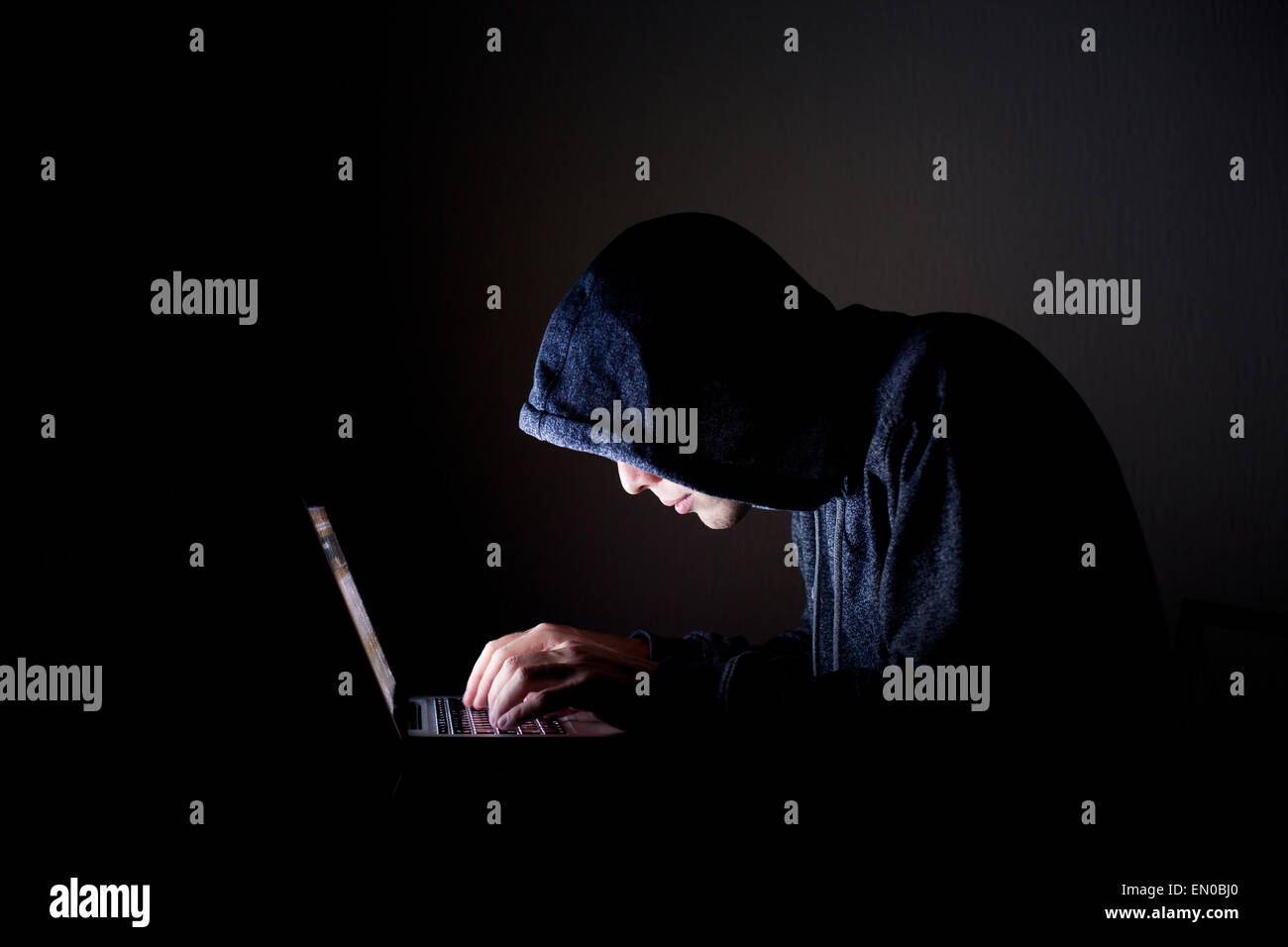 hacker with laptop - Stock Image