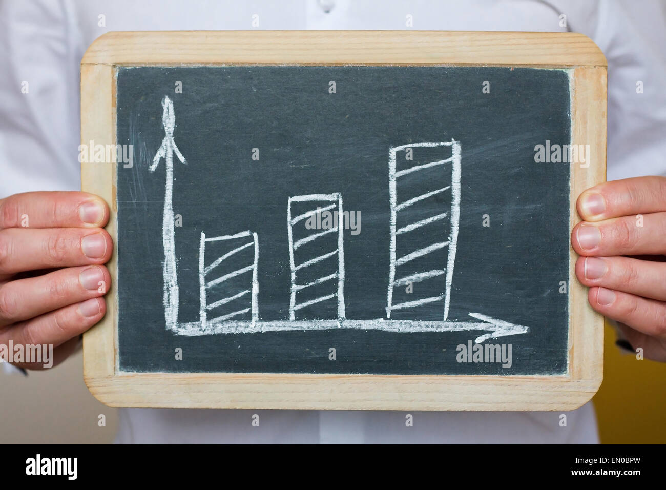doctor hands showing chalkboard with chart - Stock Image