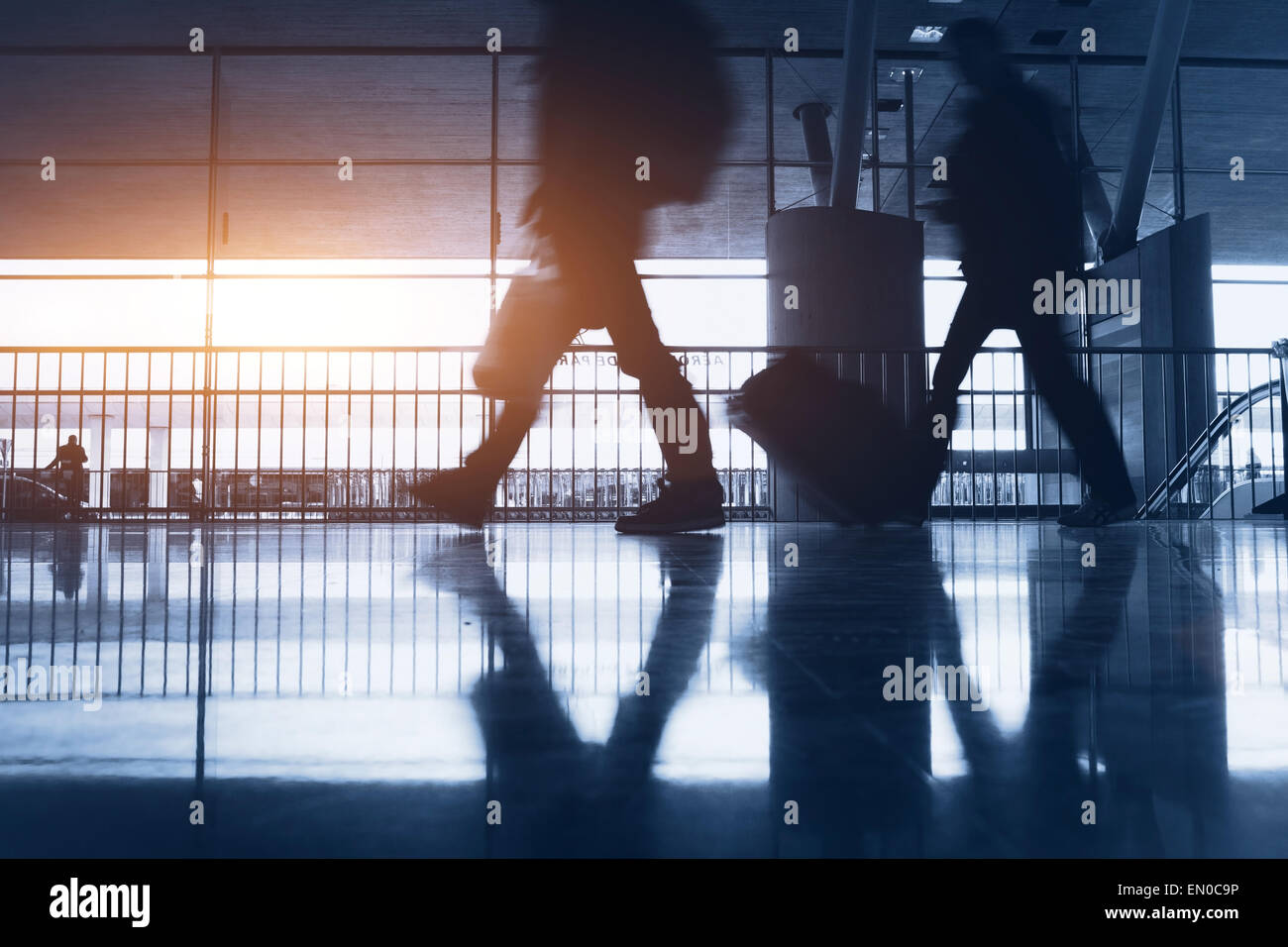 abstract airport background with walking commuters - Stock Image