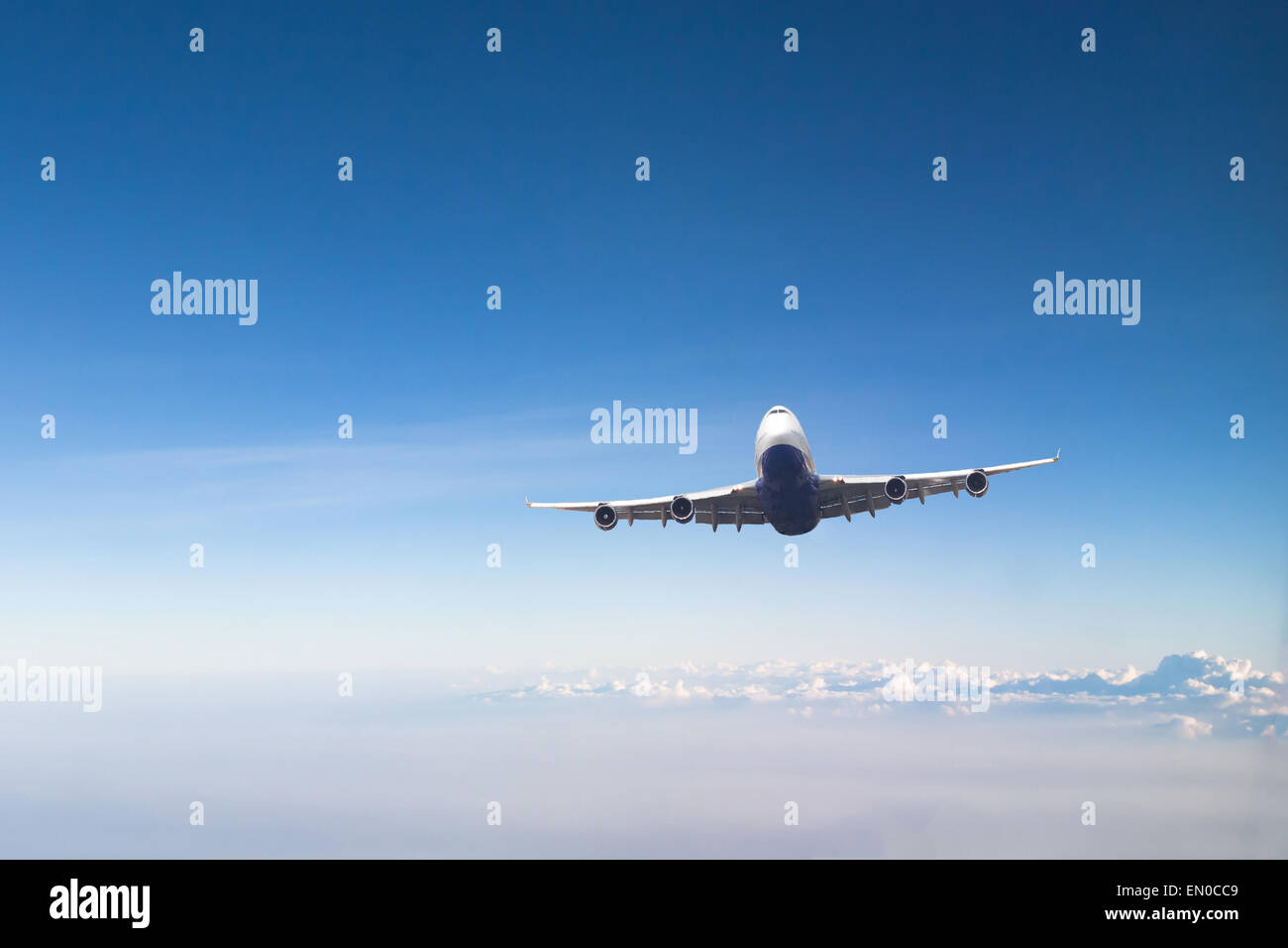 airplane in blue sky - Stock Image