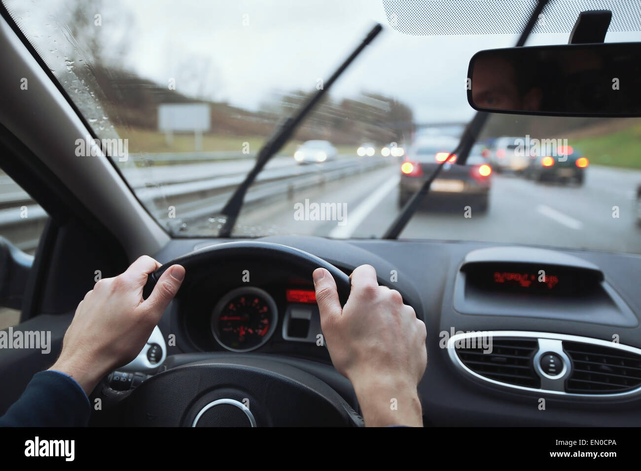 driving in hard weather conditions, rain on the windshield - Stock Image