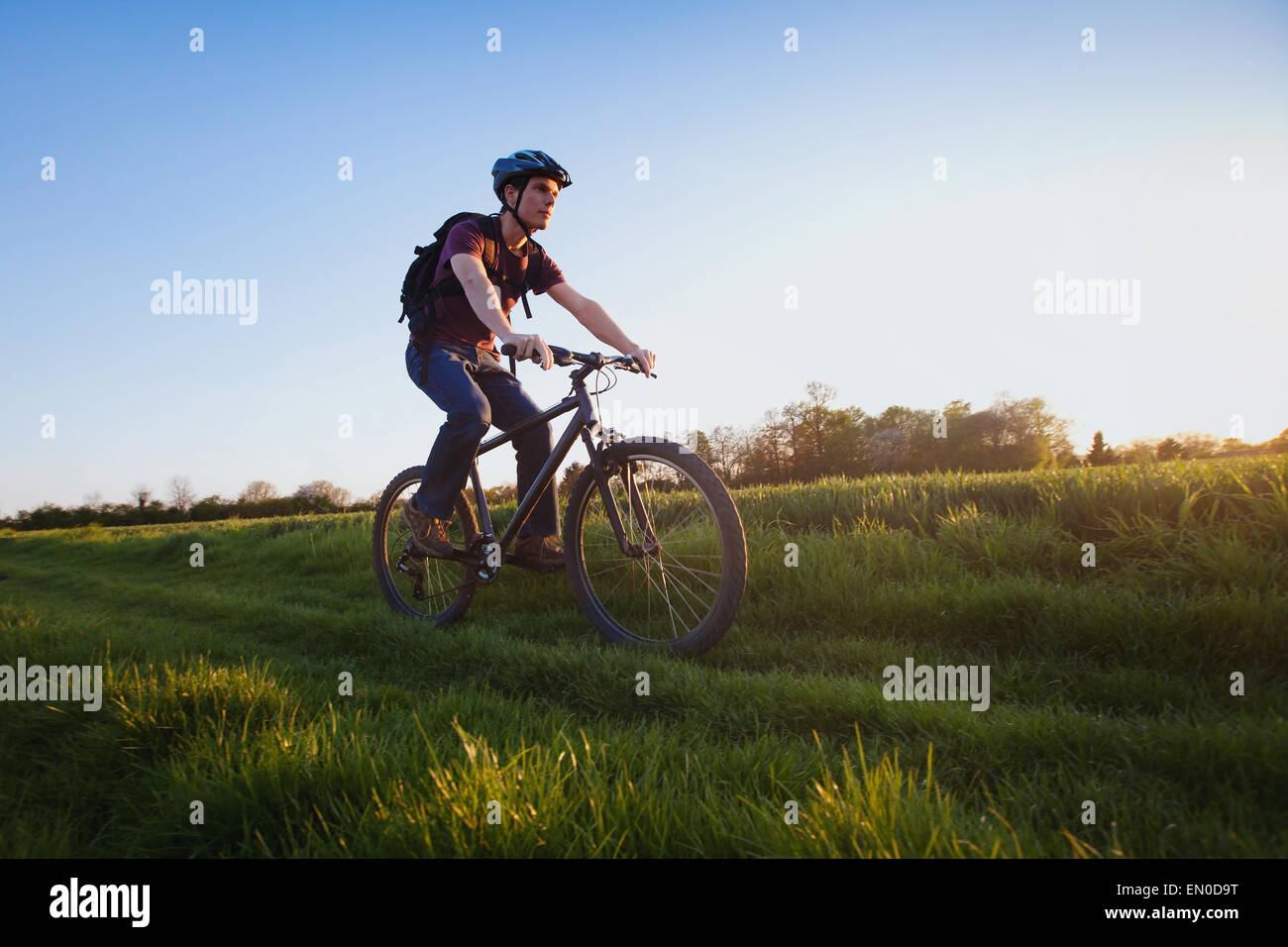 outdoor sport, young man riding bicycle in the nature - Stock Image