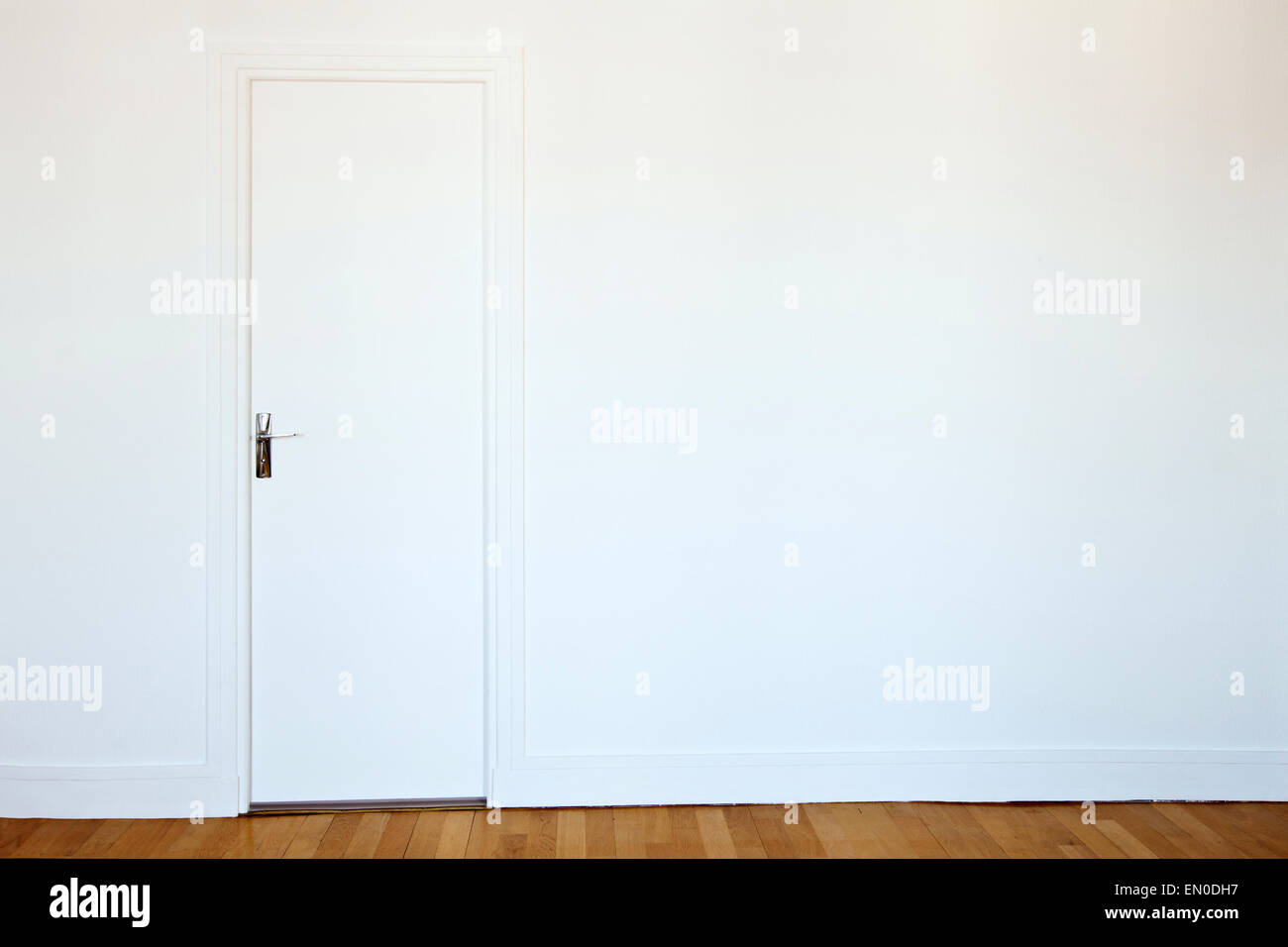 white door on white wall, real estate background - Stock Image
