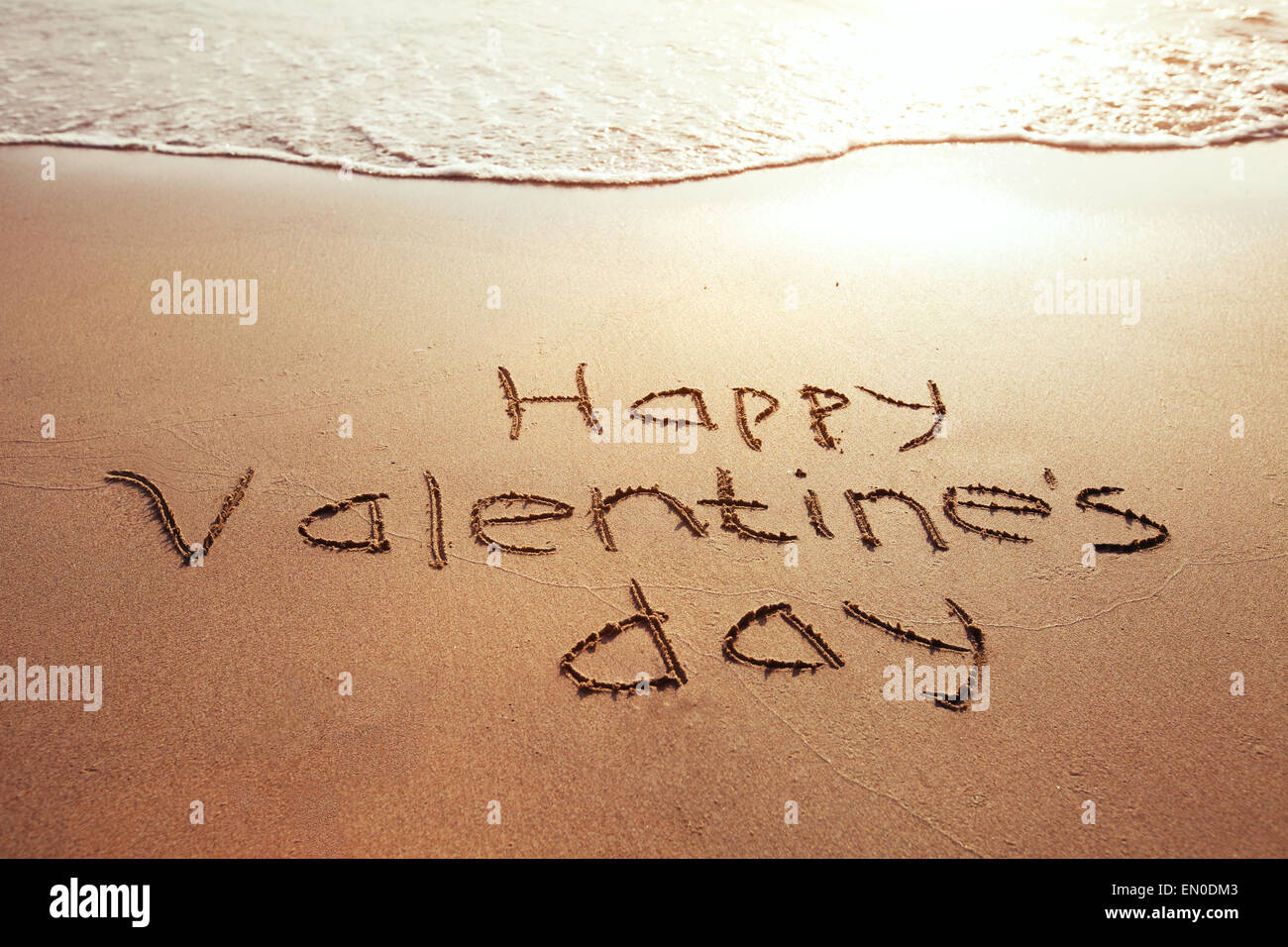 Valentine's Day card, greetings on the beach - Stock Image