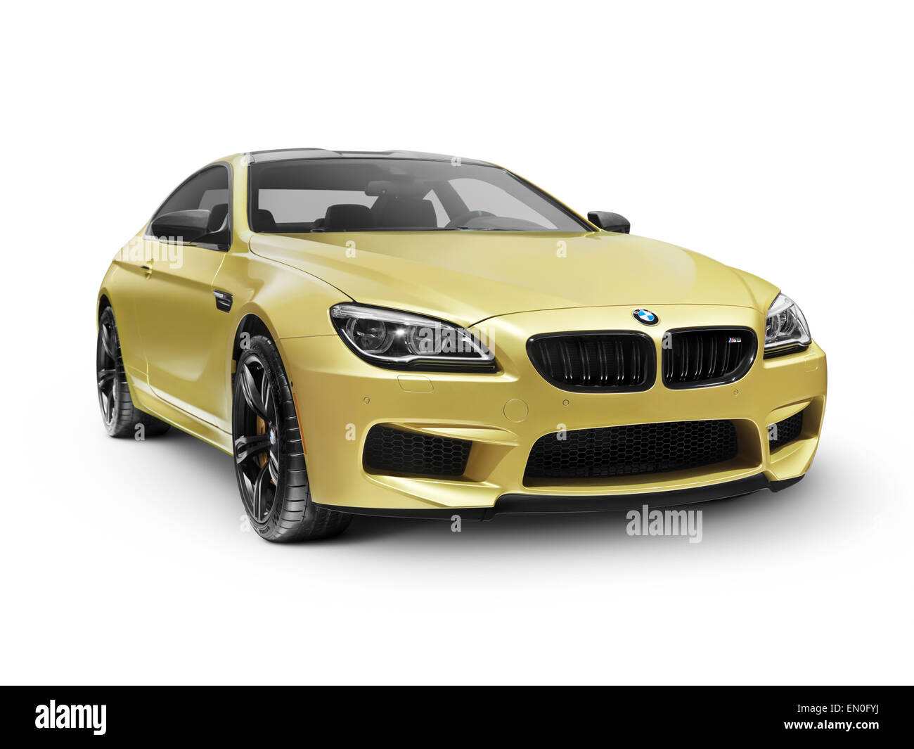 Gold 2015 BMW M6 Coupe luxury car isolated on white background with clipping path - Stock Image