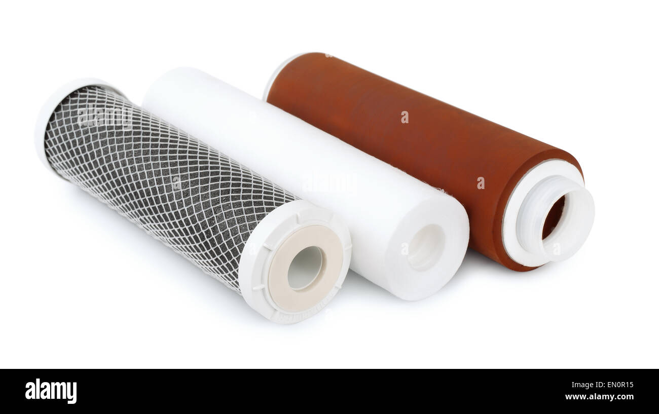 Three water filter cartridges isolated on white - Stock Image