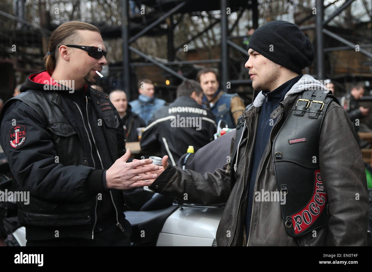 Moscow, Russia. 25th Apr, 2015. Russian boxer Dmitry Chudinov (R) seen ahead of the Moscow-Berlin motocross dedicated Stock Photo