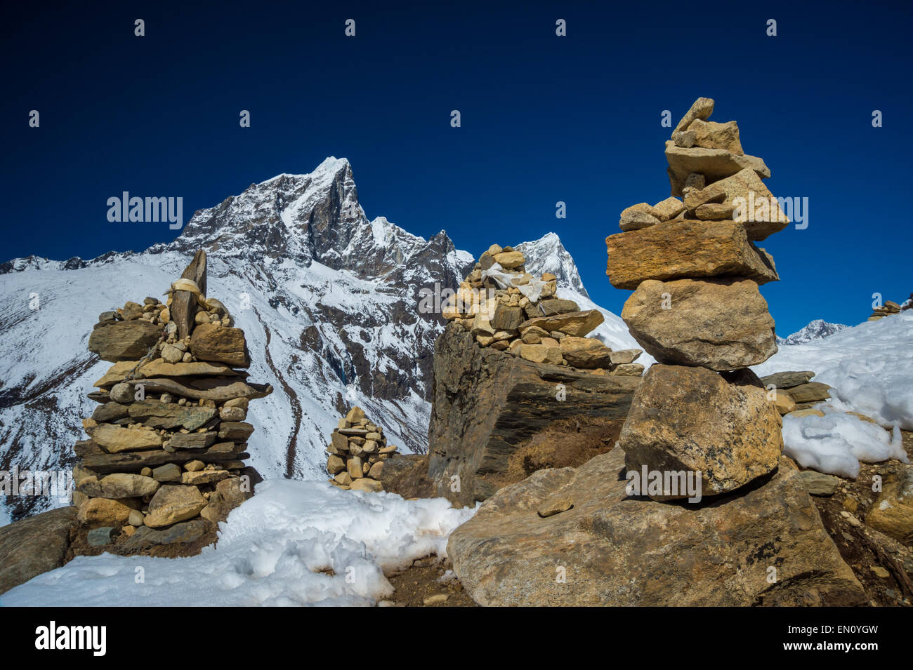 Himalayas mountain landscape with 4 stone towers - Stock Image