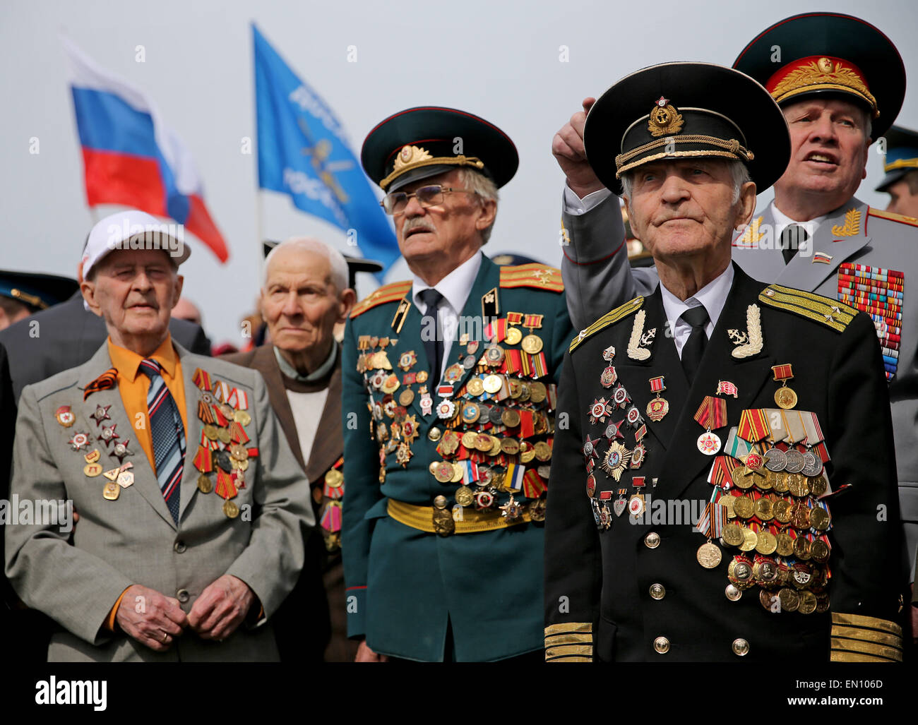 Torgau, Germany. 25th Apr, 2015. Russian veterans with multiple military decorations attend a ceremony entitled Stock Photo