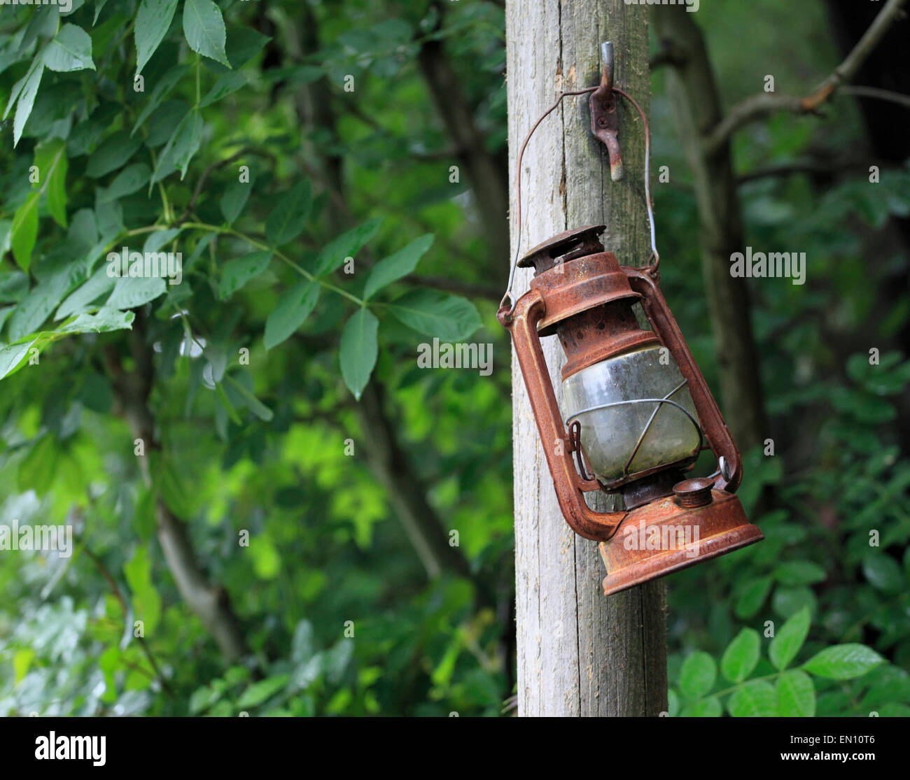 A rusty old lamp hangs forgotten at Vivian Quarry, Llanberis, Snowdonia, Wales, Europe - Stock Image