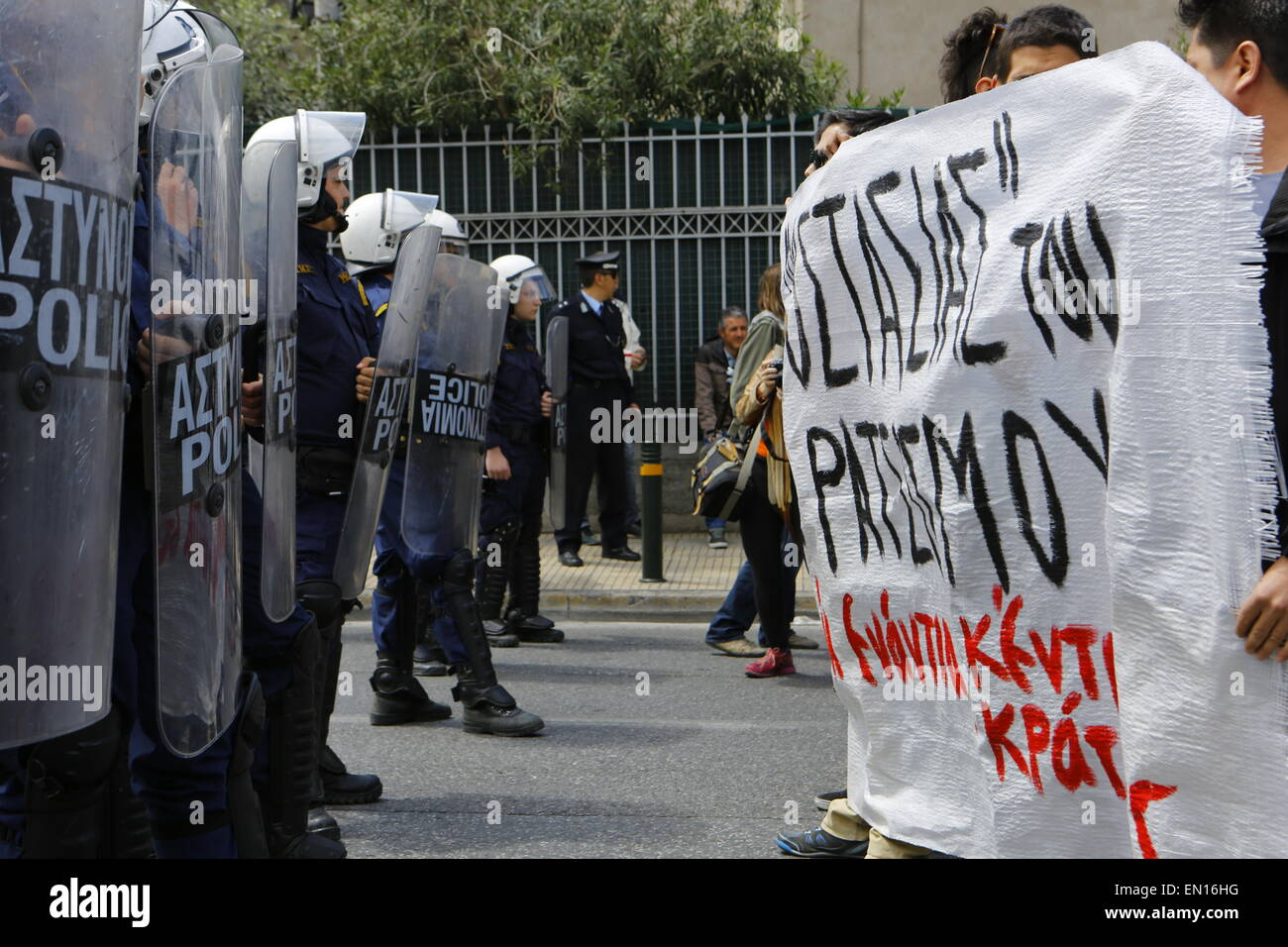 Athens, Greece. 25th April 2015. Pro-immigration protesters and riot police officers face each other outside the - Stock Image