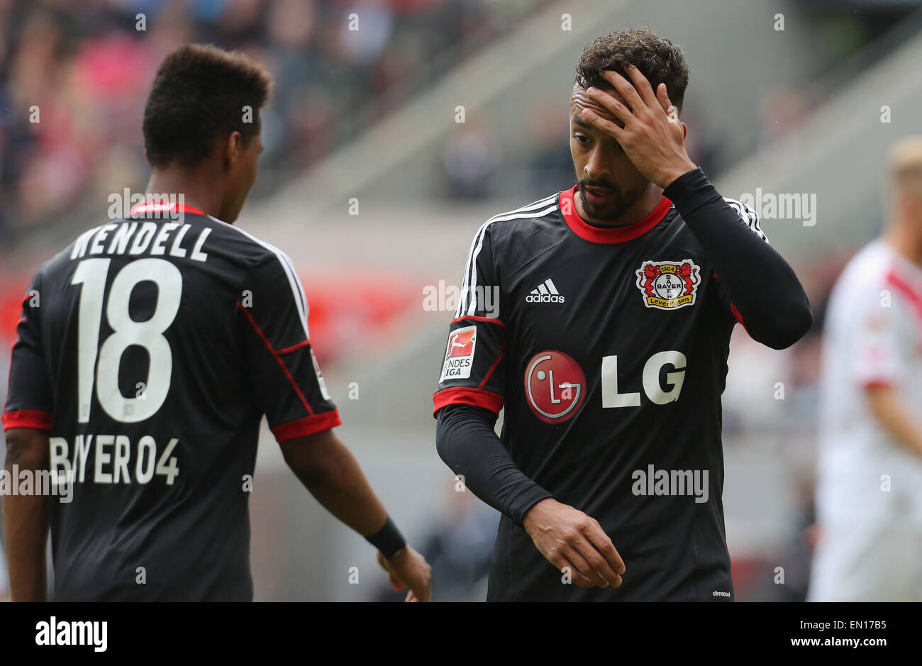 Cologne, Germany, 25Apr 2015. Bundesliga, 1. FC Koeln vs Bayer Leverkusen. Karim Bellarabi (Leverkusen, R) touches - Stock Image