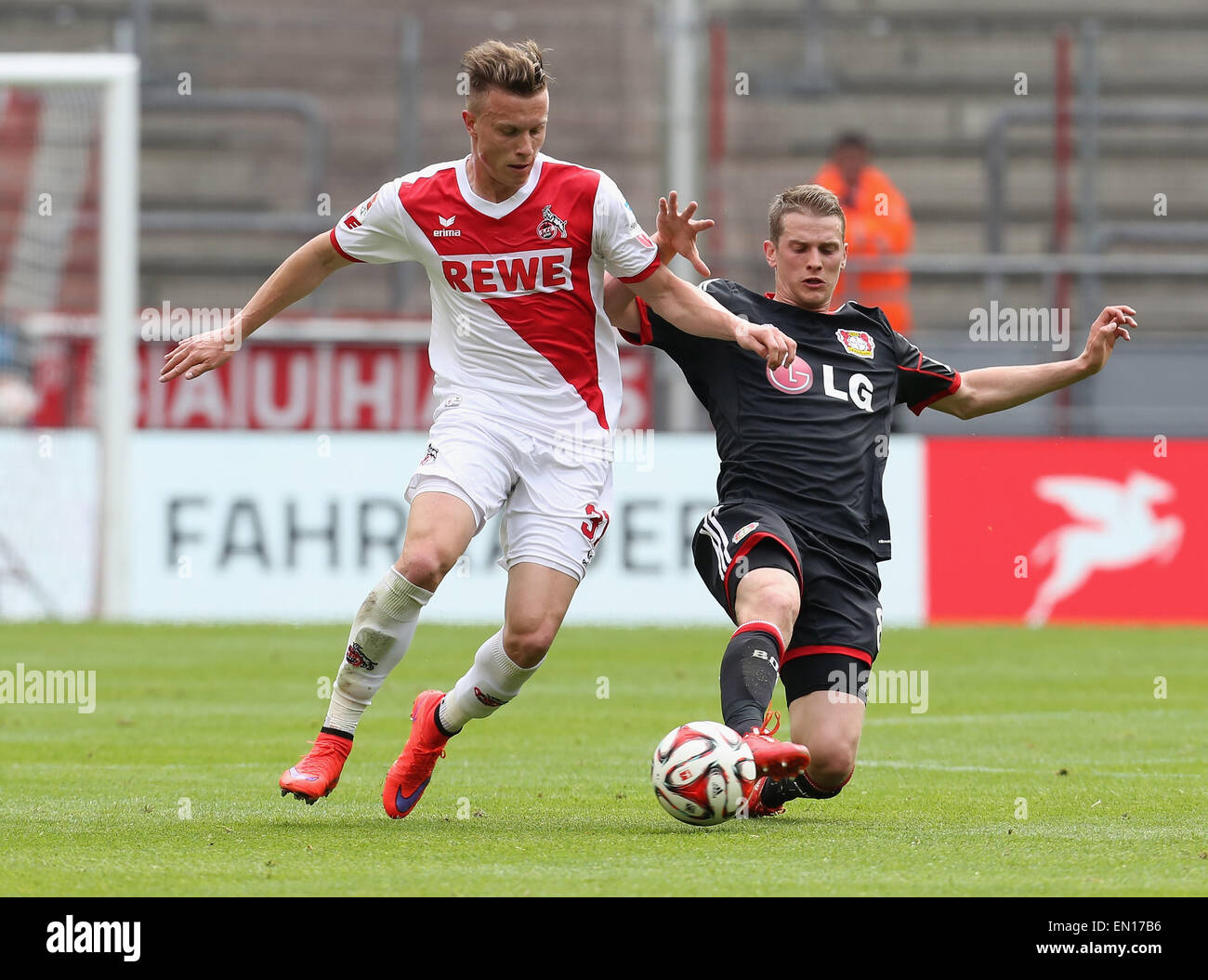 Cologne, Germany, 25Apr 2015. Bundesliga, 1. FC Koeln vs Bayer Leverkusen. Tackling between Yannick Gerhardt (Koeln, - Stock Image