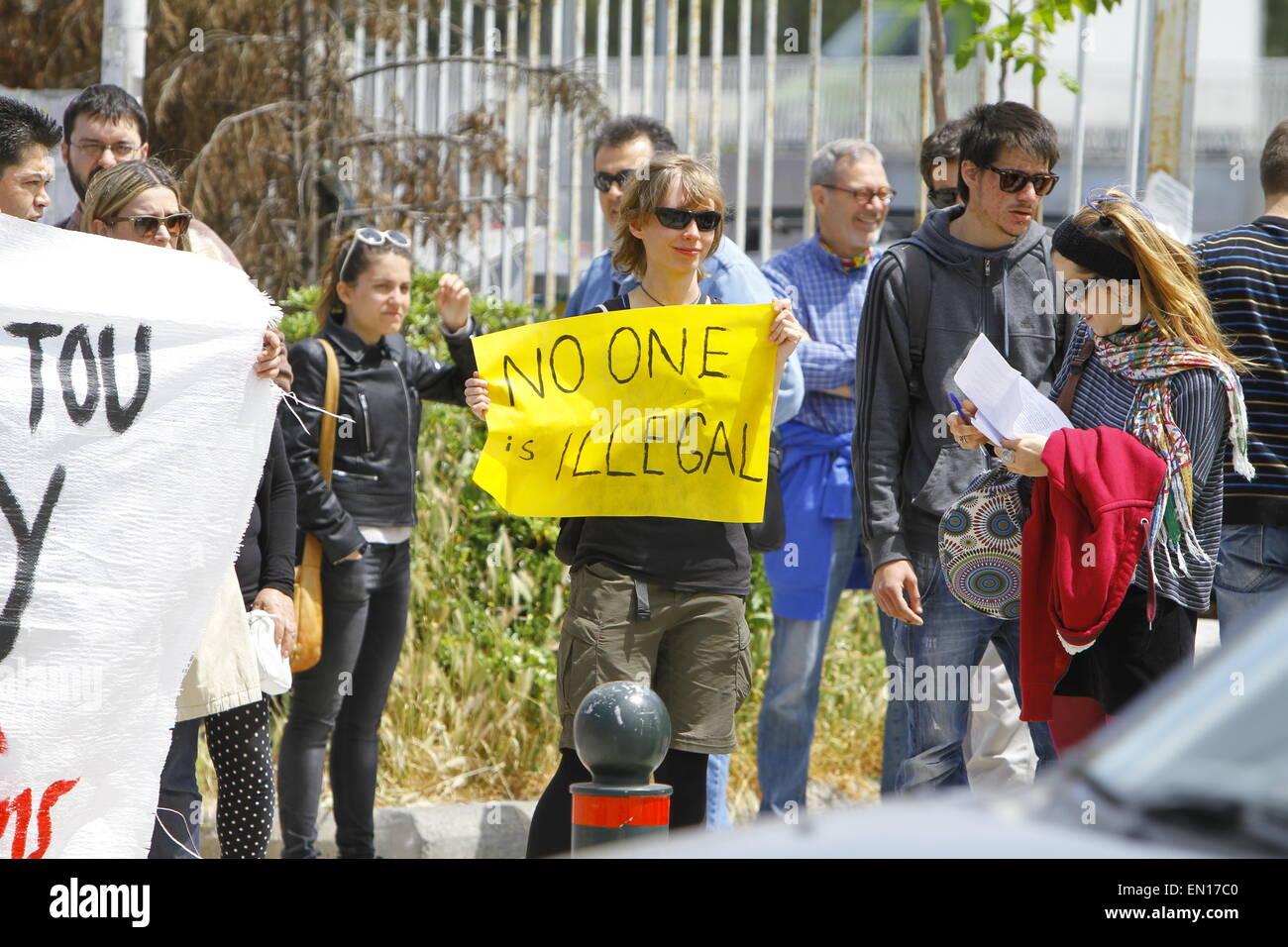 Athens, Greece. 25th Apr, 2015. A pro-immigration protester holds a sign that reads 'No one is illegal' - Stock Image